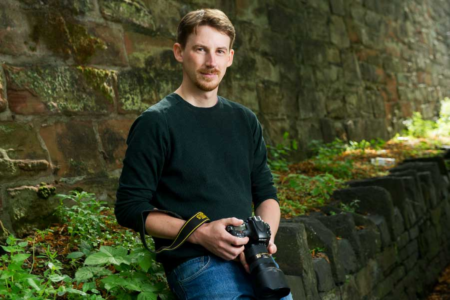 Harry Atkinson with a DSLR camera used for commercial photoshoots