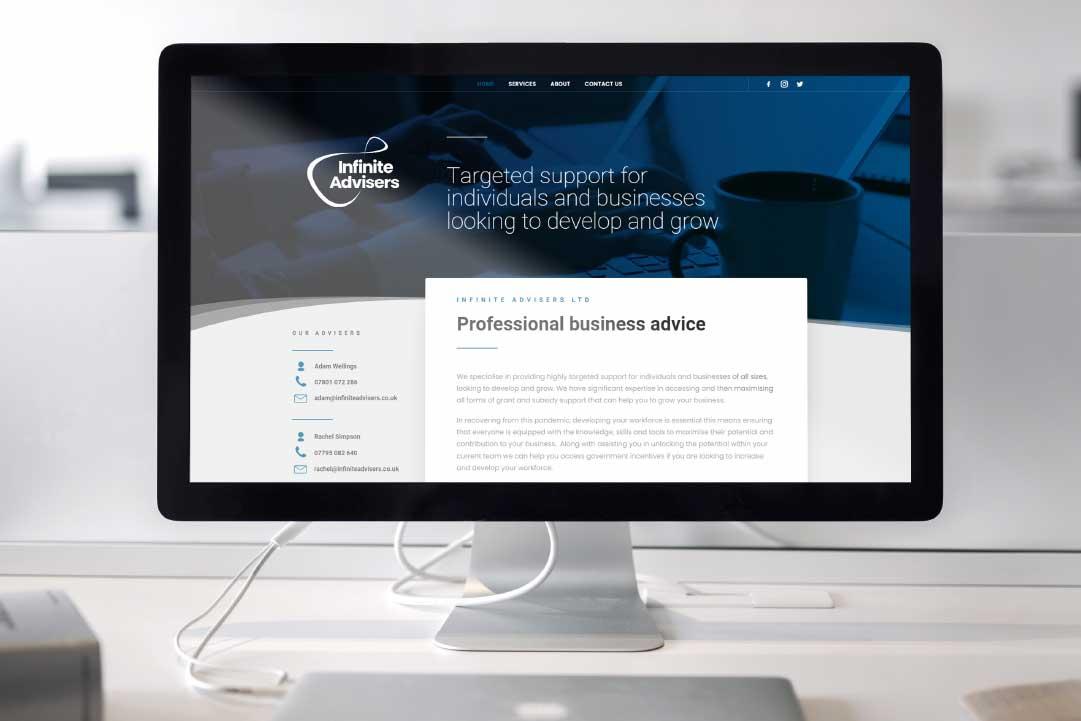 Infinite Advisors website on a large desktop Mac